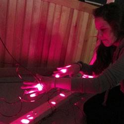 Hannah Waite plays her laser harp