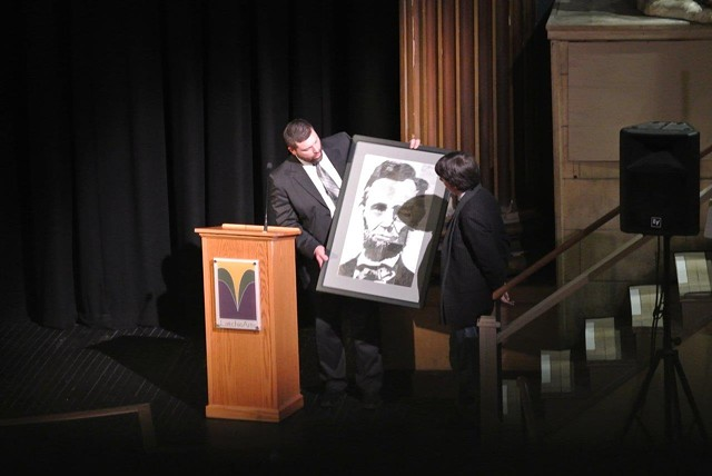 Headmaster Miller presents filmmaker Burns with a drawing of Abraham Lincoln. - COURTESY OF ARIA CARTER