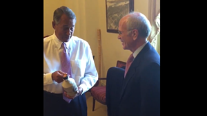House Speaker John Boehner studies a sweet offering from Congressman Peter Welch.