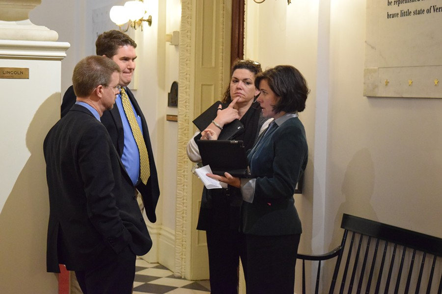 House Speaker Shap Smith (D-Morristown), left, talks Wednesday with Reps. Oliver Olsen (I-Londonderry), Laura Sibilia (I-Dover) and Mitzi Johnson (D-Grand Isle)  about an education consolidation bill. - TERRI HALLENBECK