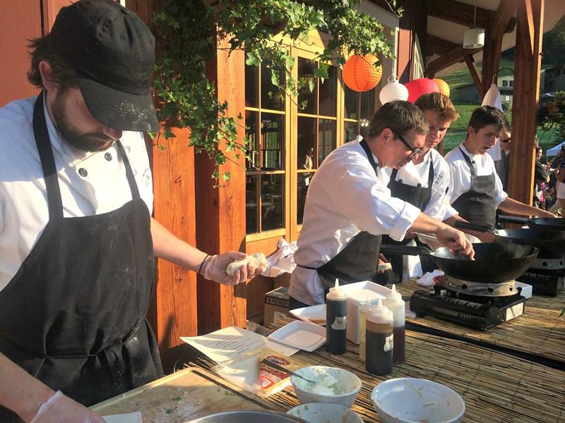 Inn at Round Barn Farm team makes spring rolls
