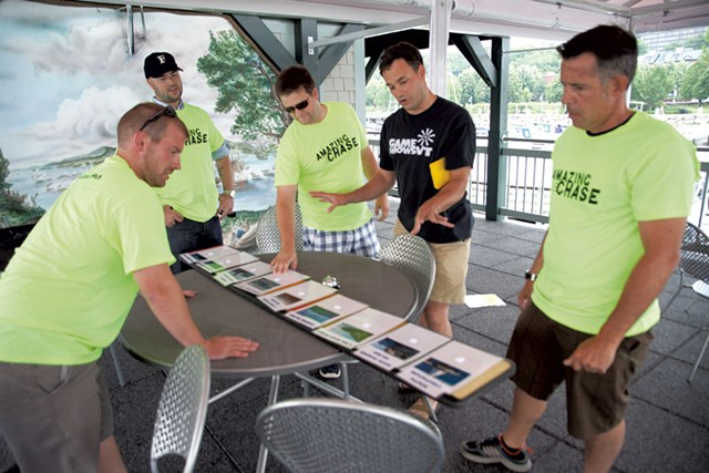 Jamie Polli (black shirt) looks at the Lake Champlain landmark challenge with Dealer.com employees - MATTHEW THORSEN