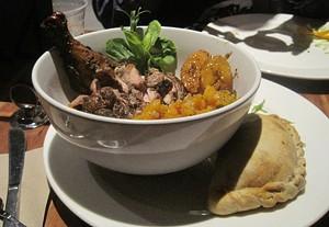 Jerk chicken bowl with Jamaican pork patty