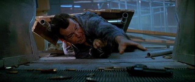 John McClane reaches for his gun in the film's cleverest sequence. - 20TH CENTURY FOX PICTURES