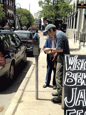Jon Kohn and his mother, Viola, feeding a meter on College Street - KEN PICARD