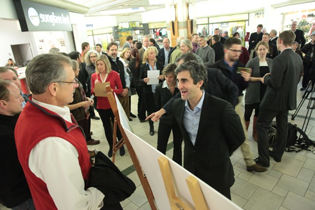 Lake Champlain Regional Chamber of Commerce president Tom Torti speaks with Mayor Miro Weinberger - MATTHEW THORSEN