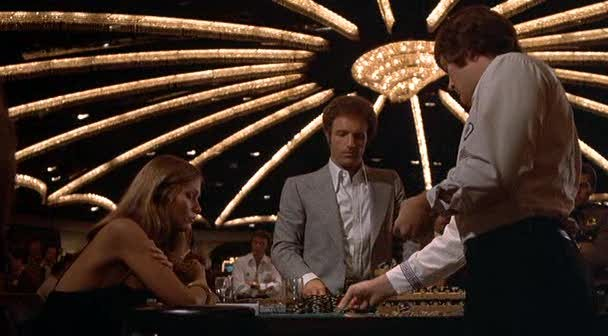 Lauren Hutton and James Caan in The Gambler - PARAMOUNT PICTURES