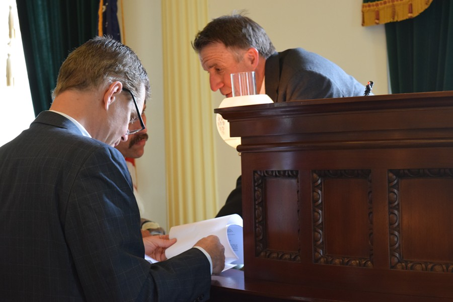 Lt. Gov. Phil Scott confers Friday with John Bloomer, Senate secretary during Senate floor action. - TERRI HALLENBECK