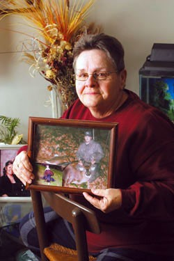 Linda Rodriguez holding a picture of her son, Omar Rodriguez