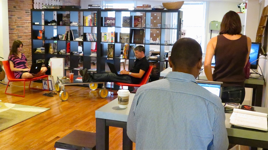 Coworkers coworking at Local 64's current space - COURTESY OF LOCAL 64