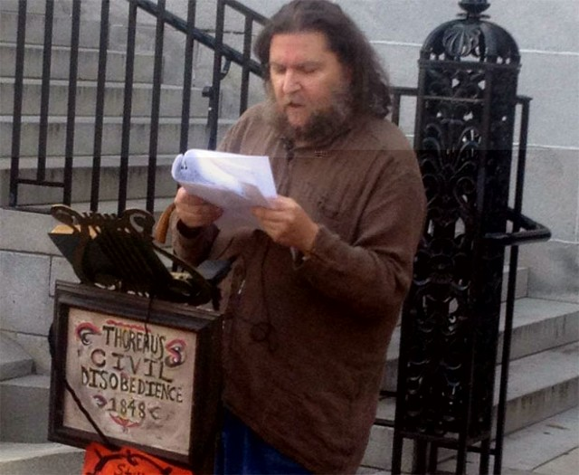 Marc Awodey, reading in front of Burlington City Hall in August 2012