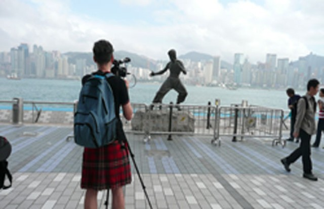 Mark Cousins films a statue of Bruce Lee in The Story of Film