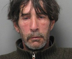 Mark Delude after his arrest in May. - BURLINGTON POLICE DEPARTMENT