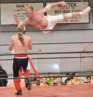 Michael Monroe drops a flying elbow on Viper the Ninja