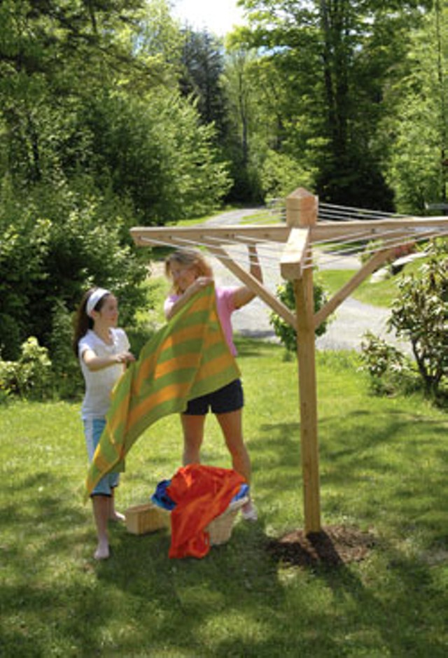 "Michelle Baker and helper with a ""Garden Party"" clothesline"