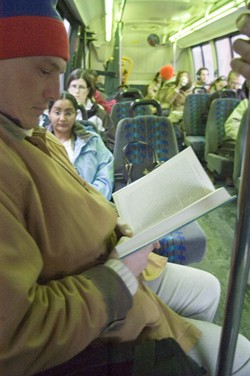 Mike Winslow reads on the bus to Vergennes - MATTHEW THORSEN
