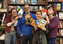 Bear Pond staff celebrate the grant. From left to right: Amanda Menard, Chris MacDonald, store owner Claire Benedict; in front, children's room manager Jane Knight. - COURTESY OF BEAR POND BOOKS