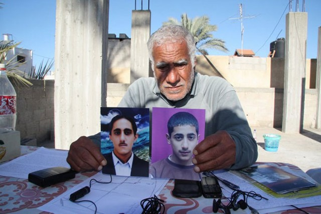 Muhammed Shurrab holds photos of his murdered sons