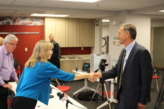 Nancy Remsen shakes Gov. Peter Shumlin's hand last month before the Burlington Free Press' gubernatorial debate. - PAUL HEINTZ