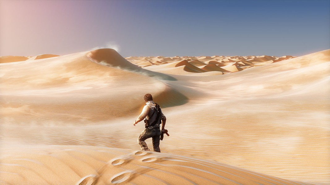 Nathan Drake treks through the desert in Uncharted 3 - NAUGHTY DOG STUDIOS