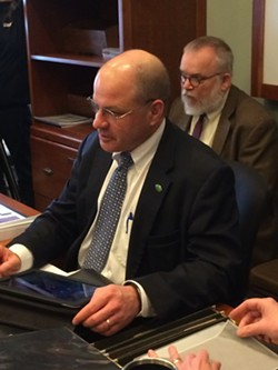 Lawrence Miller prepares to report to the House Appropriations Committee. - NANCY REMSEN