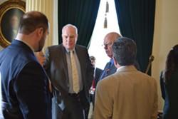 Sen. Joe Benning (R-Caledonia), center, strategizes with fellow Republicans on Tuesday as the Senate prepared to debate a climate-change resolution. - TERRI HALLENBECK