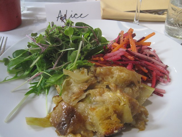Onion confit, cabbage and cheddar panade in the style of Zuni Café's Judy Rodgers. Served with root veggie slaw and the season's first spring greens