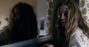PARENTAL GUIDANCE Charpentier is torn between two mommies — one tattooed, one terrifying — in Muschietti's horror flick.