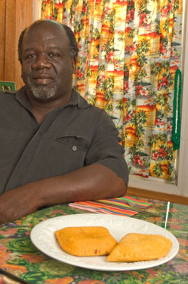 Patrick Brown with a plate of Jamaican meat patties - MATTHEW THORSEN