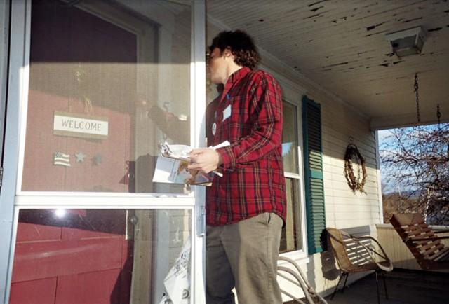 Peter Merritt knocks on the door of a Littleton home