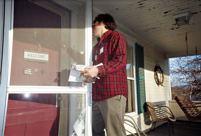 Peter Merritt knocks on the door of a Littleton home