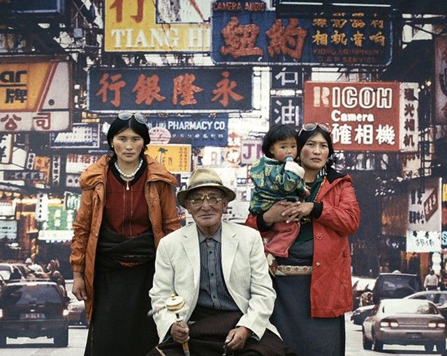 """PICTURE IMPERFECT: A Tibetan family poses before the likeness of an urbanscape they may never see in """"Butter Lamp."""""""