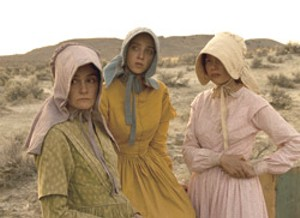 PRAIRIE SLOG Williams (far right) plays a pioneer on a grueling trek in Reichardt's unusual take on the western.