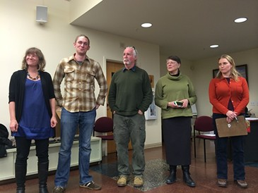 Progressive candidates Selene Colburn, Max Tracy, Jane Knodell and Sara Giannoni surround mayoral candidate Steve Goodkind at a January nominating caucus. - ALICIA FREESE