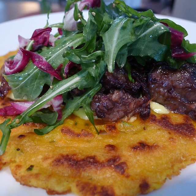 Pumpkin flatbread topped with wine-braised short ribs - CORIN HIRSCH