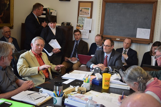 Sen. Bobby Starr (D-Essex/Orleans) discusses a proposed state employee retirement incentive with Administration Secretary Justin Johnson on Monday. - TERRI HALLENBECK