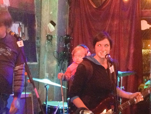 Rebekah Whitehurst of the Cave Bees, with child