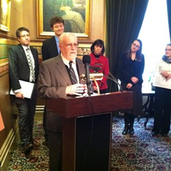 Rep. David Deen (D-Westminster) speaks at the Statehouse in support of banning microbeads found in some personal care products. - TERRI HALLENBECK