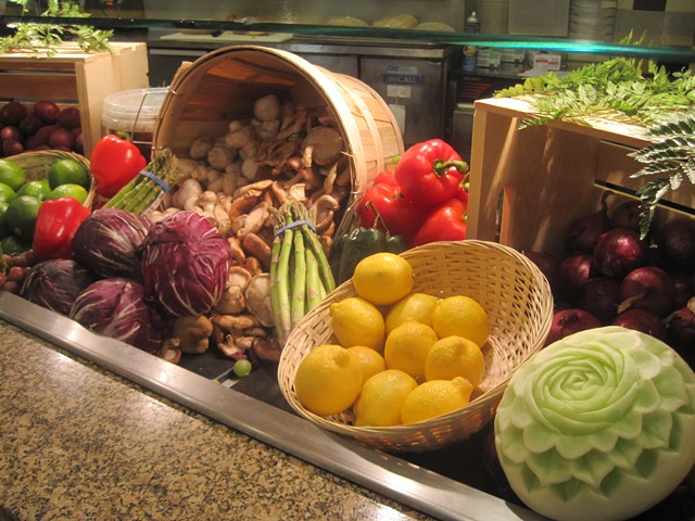 Representative produce, including a melon carved by chef Marin