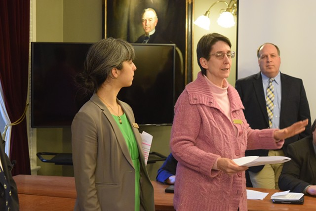 Reps. Diana Gonzalez (P/D-Winooski), left, and Anne Donahue (R-Northfield) discuss an anti-discriminatory resolution Thursday at the Statehouse. - TERRI HALLENBECK
