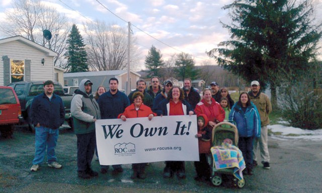 Residents celebrate their acquisition of Homestead Acres mobile-home park on Jan. 1, 2012