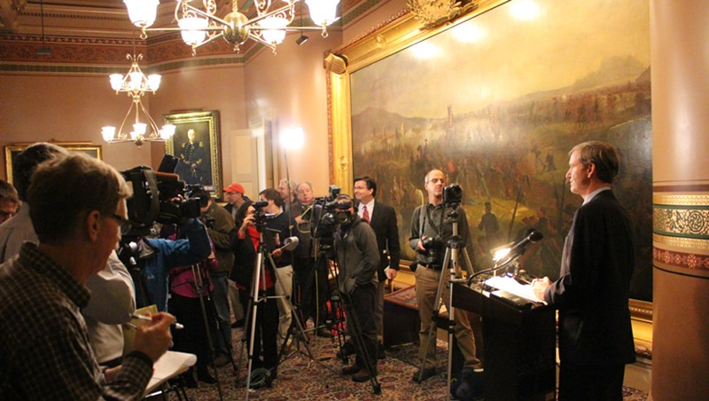 Scott Milne speaks to reporters Monday at the Statehouse.