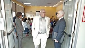 Sears leaves a DCF public meeting in Winooski
