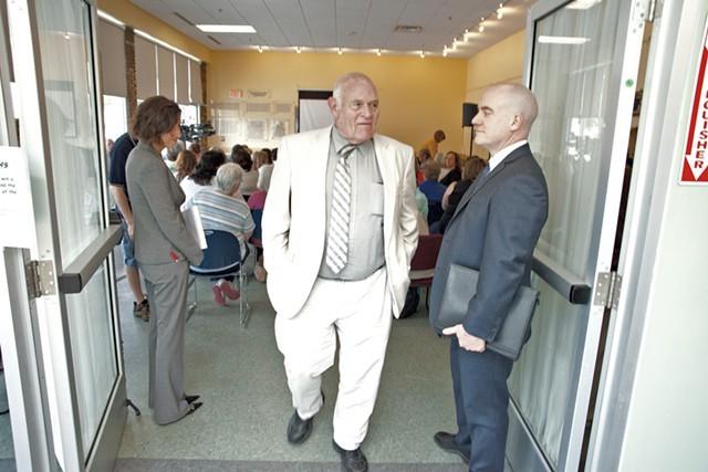 Sears leaves a DCF public meeting in Winooski - MATTHEW THORSEN