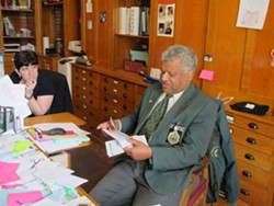 Sergeant-at-Arms Francis Brooks works in his Statehouse office Thursday morning. - TERRI HALLENBECK