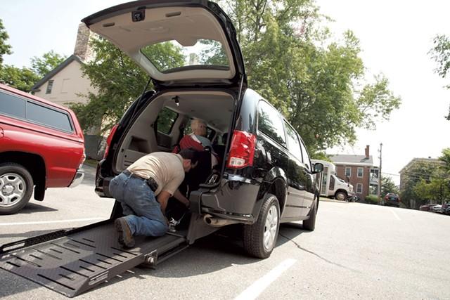Shelley Palmer assists a passenger into a taxi - MATTHEW THORSEN