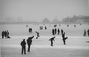 """COURTESY OF DARKROOM GALLERY - """"Skaters, Beijing"""" by Len Speier"""