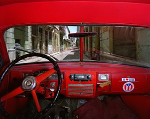 "COURTESY OF BIGTOWN GALLERY - ""Sol and Cuba, Old Havana, looking north from Albert Rojas' 1951 Plymouth"" by Alex Harris"