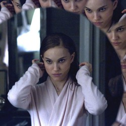SPLITTING IMAGE Portman finds herself literally cracking up in Aronofsky's ballet thriller.