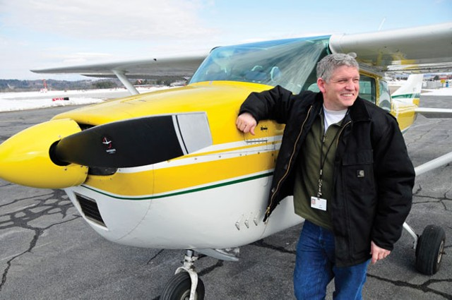 State pilot Guy Rouelle with his Cessna at Knapp Airport in Berlin - JEB WALLACE-BRODEUR